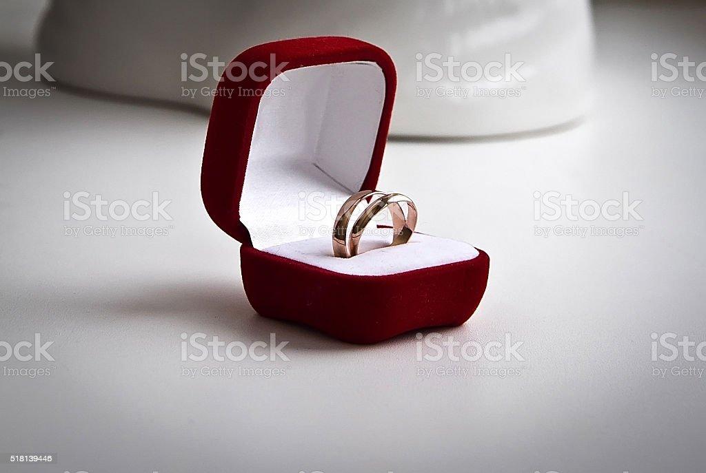 pair of gold wedding rings in a velvet box stock photo