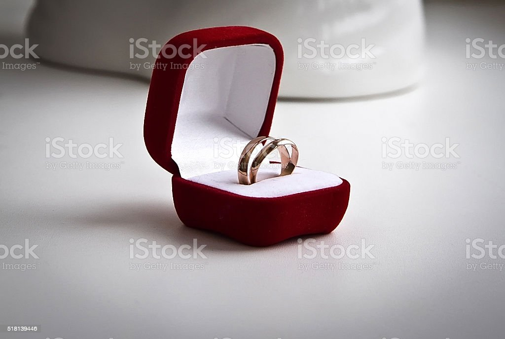 pair of gold wedding rings in a velvet box stock photo