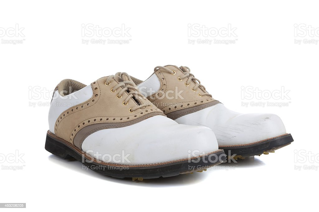 Pair of golf shoes on a white background stock photo