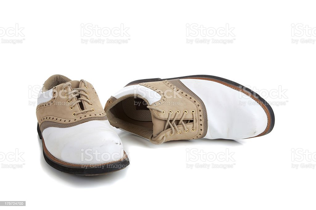 Pair of golf shoes on white stock photo