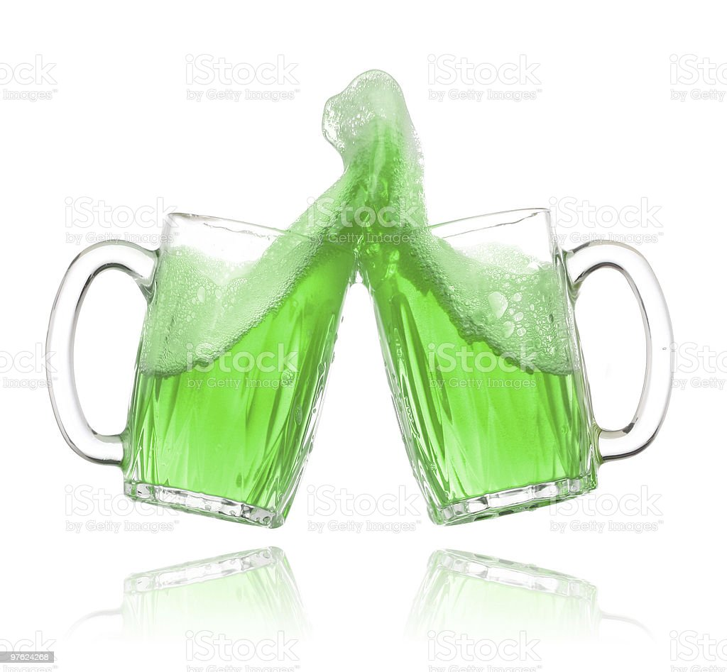 Pair of green beer glasses making a toast royalty-free stock photo