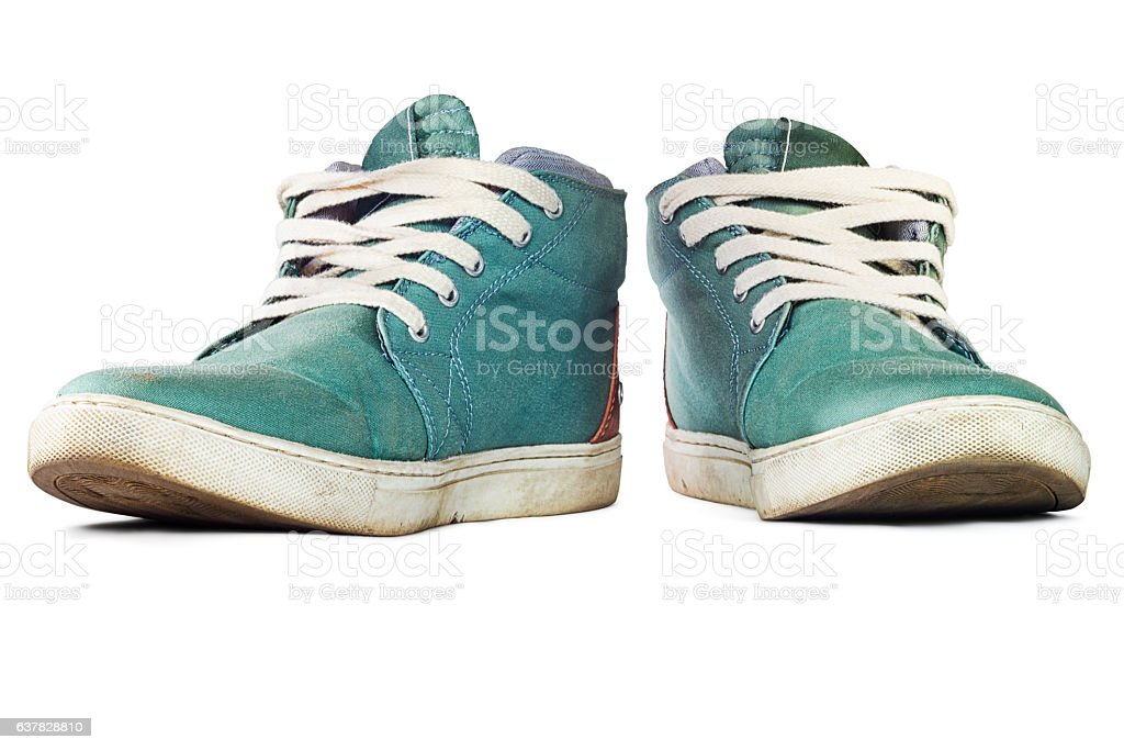 Pair of green sneakers isolated on white background stock photo