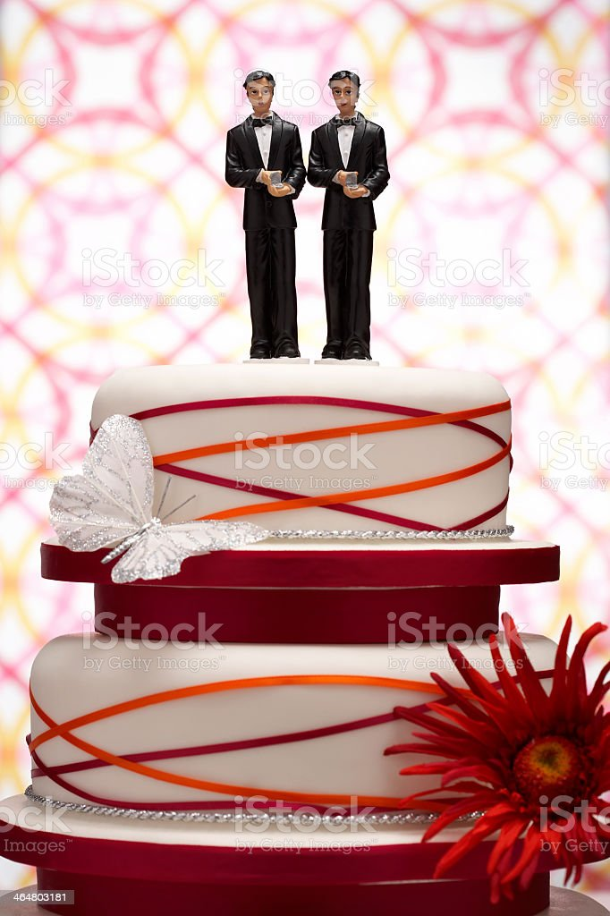 Pair of groom figures on a butterfly swirl wedding cake stock photo