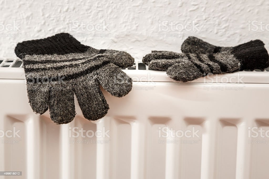 Pair of hand knitted striped woolen gloves stock photo