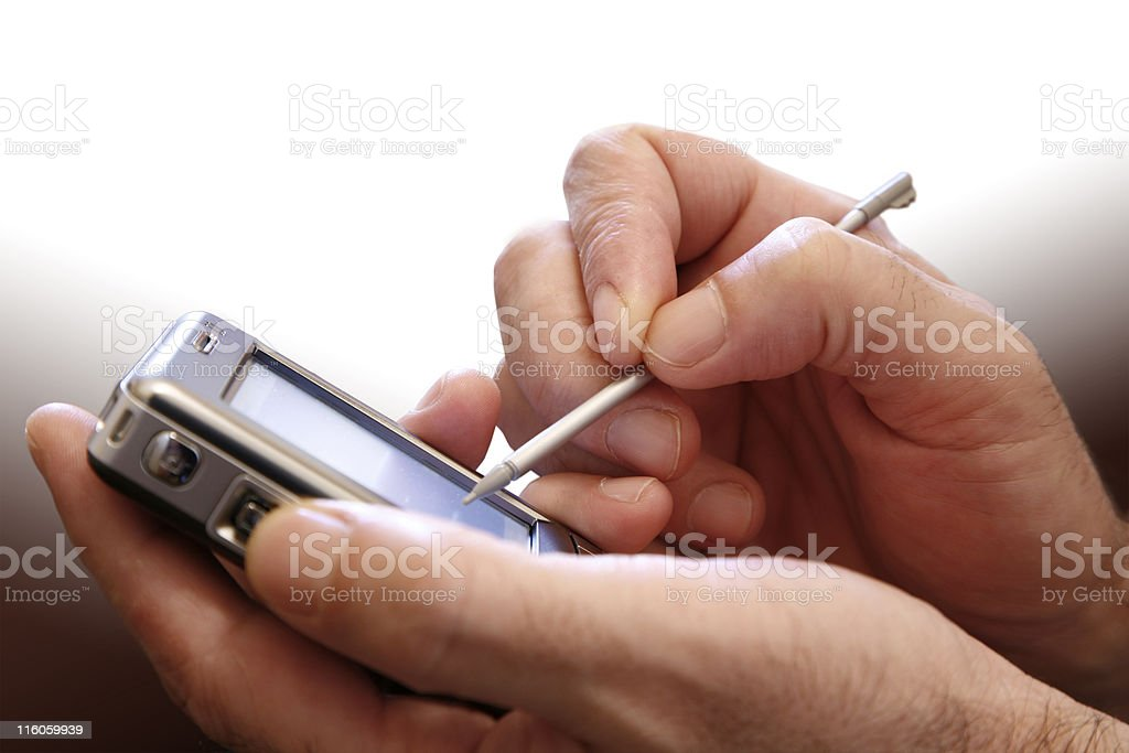 Pair of hands holding a PDA and stylus stock photo