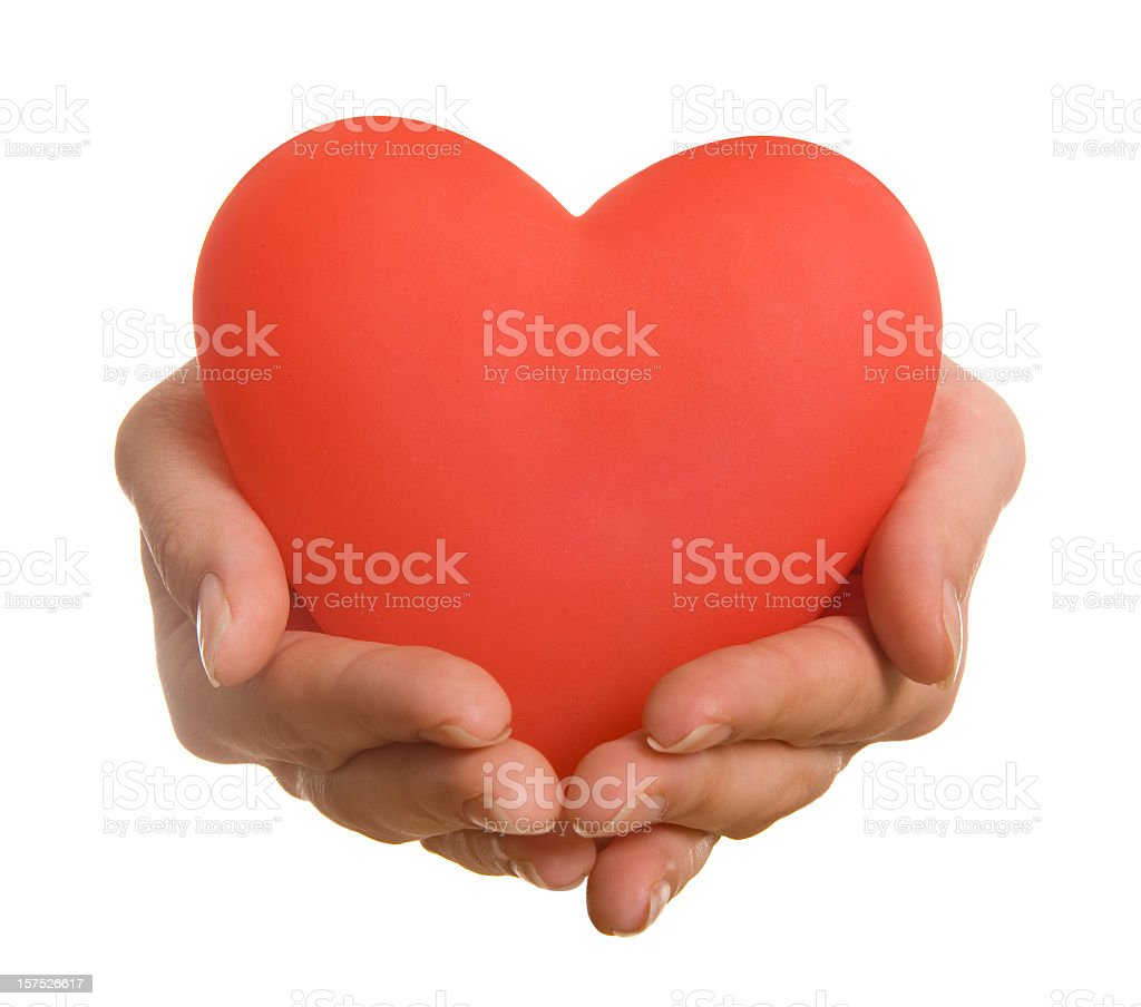 Pair of hands holding a Red heart royalty-free stock photo