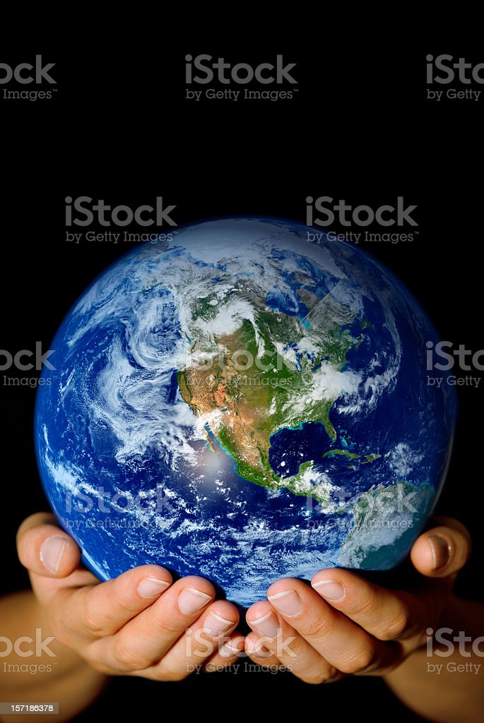 Pair of hands holding the Earth with North America visible stock photo