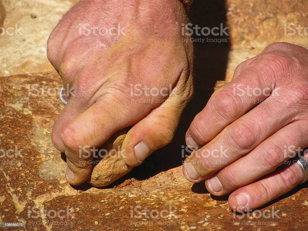 Pair of Hands on Red Rock royalty-free stock photo