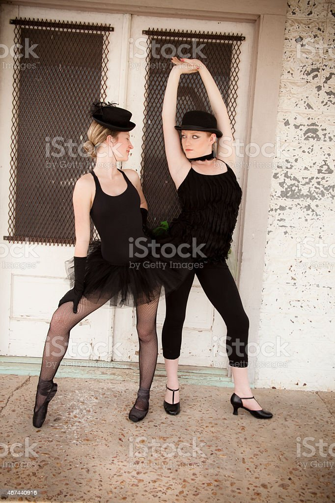 Pair of jazz ballet dancers wearing costume pose for camera. stock photo