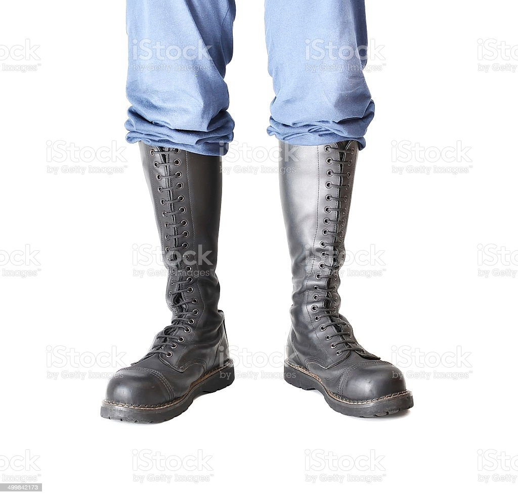 Pair of knee-high 20 eyelet black steel-toe boots stock photo