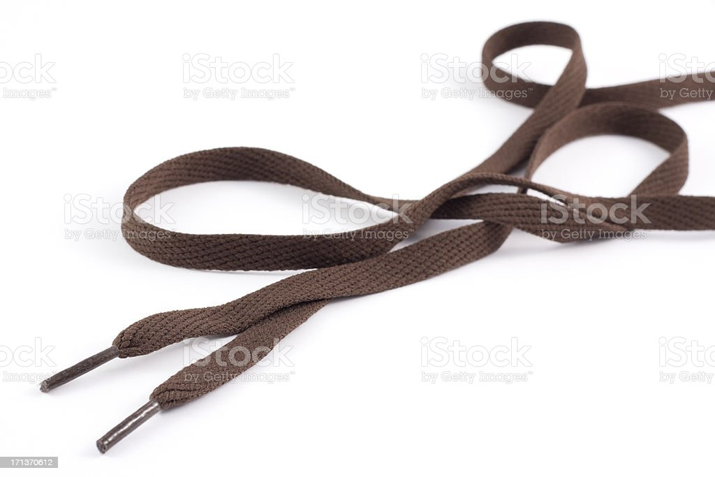 Pair of long brown shoe laces on a white background stock photo