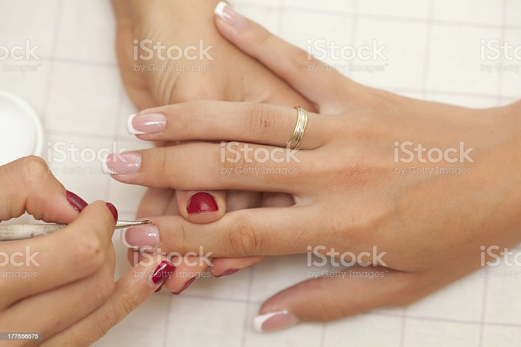 Pair of mature hands having the nails filed royalty-free stock photo