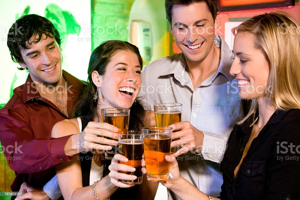 Pair of men and women having a drink royalty-free stock photo