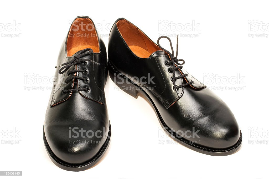 A pair of men's black dress shoes stock photo