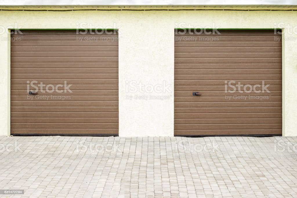 Pair of modern garage doors. Large automatic up and over garage doors...