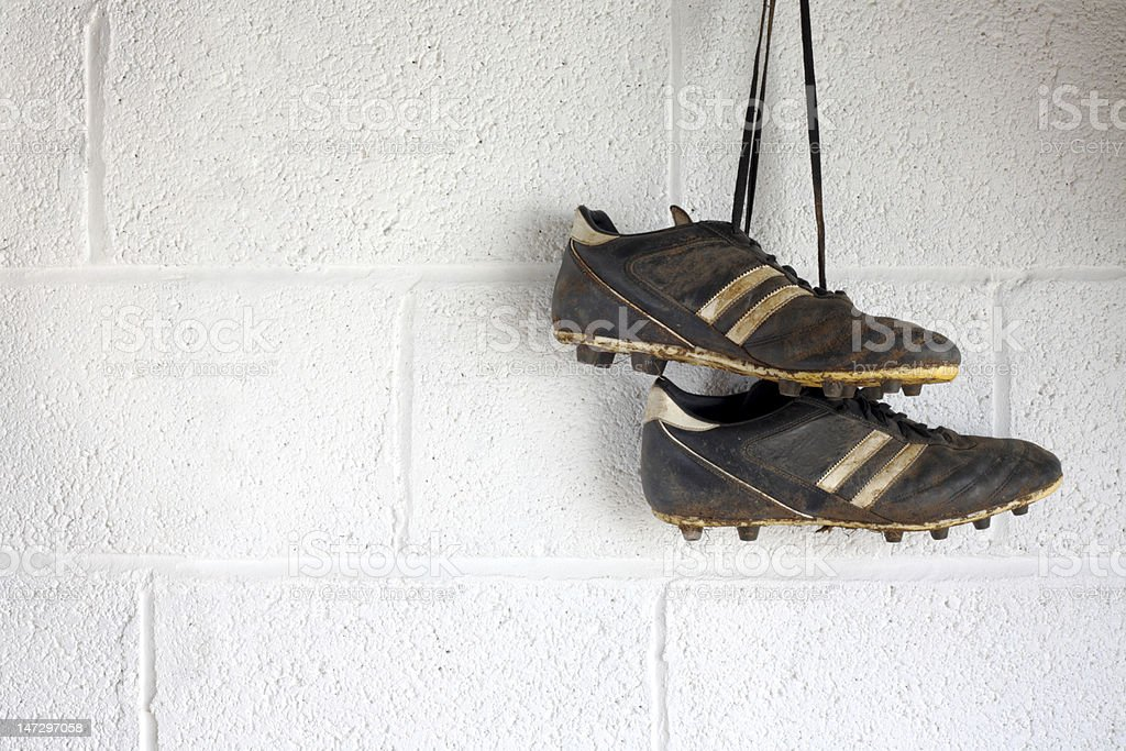 Pair of muddy black football boots stock photo