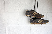 Pair of muddy black football boots