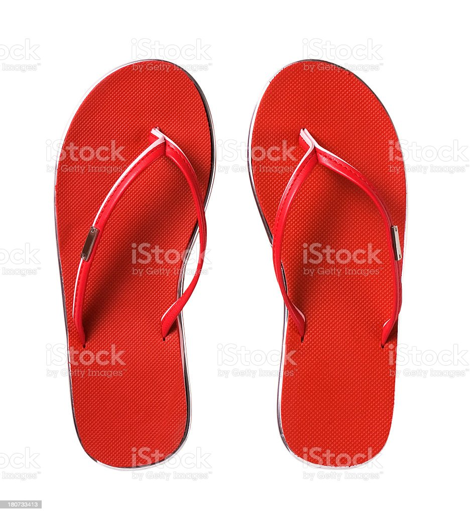 Pair of new red flip flops against white background stock photo