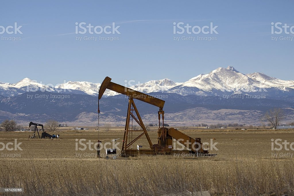 Pair of oil pumpers and Rocky Mountains, Colorado stock photo