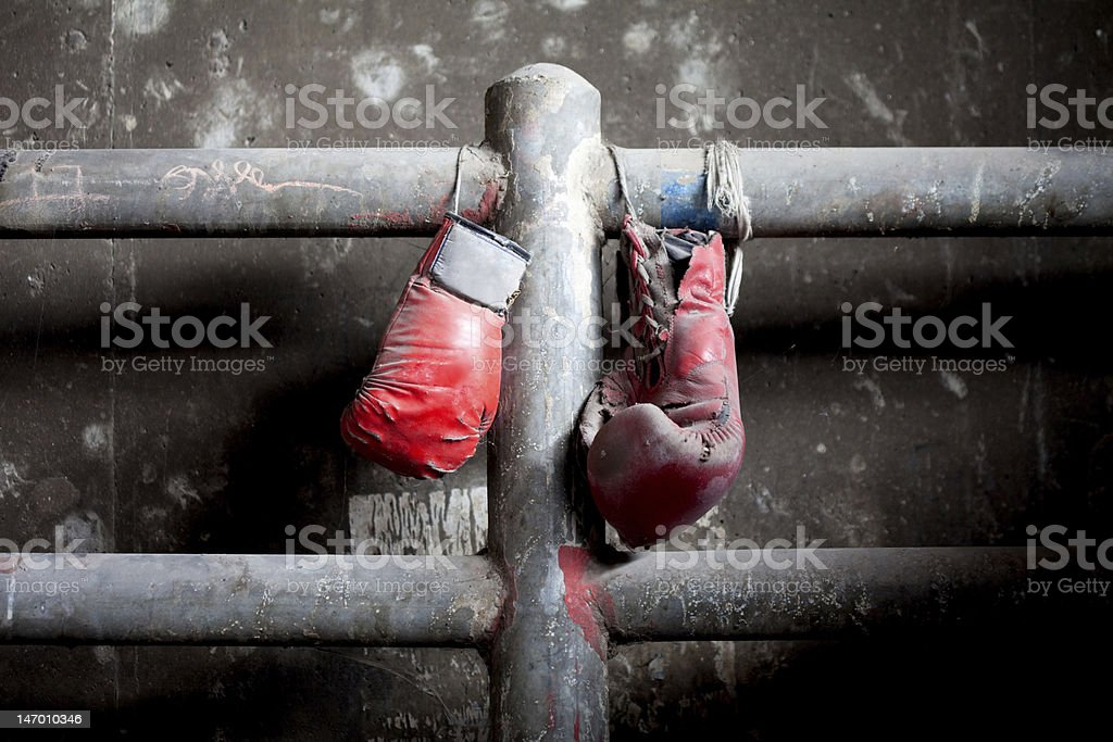 Pair of old and tattered boxing gloves stock photo
