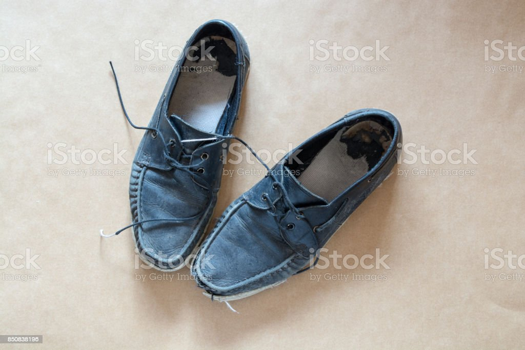 Pair of Old Blue men's lace up shoes - in bad condition. stock photo