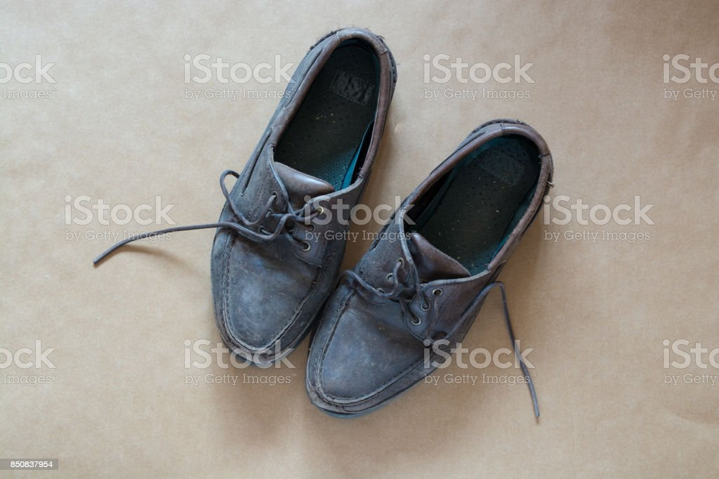 Pair of old brown men's lace up shoes - very badly used stock photo
