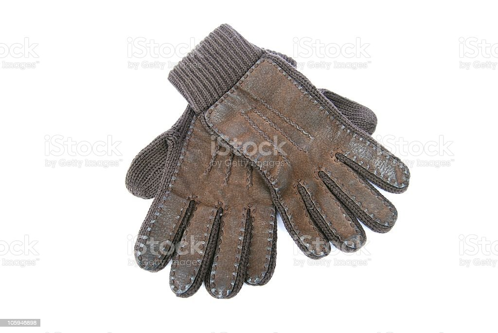 Pair of old brown wool gloves isolated on white stock photo