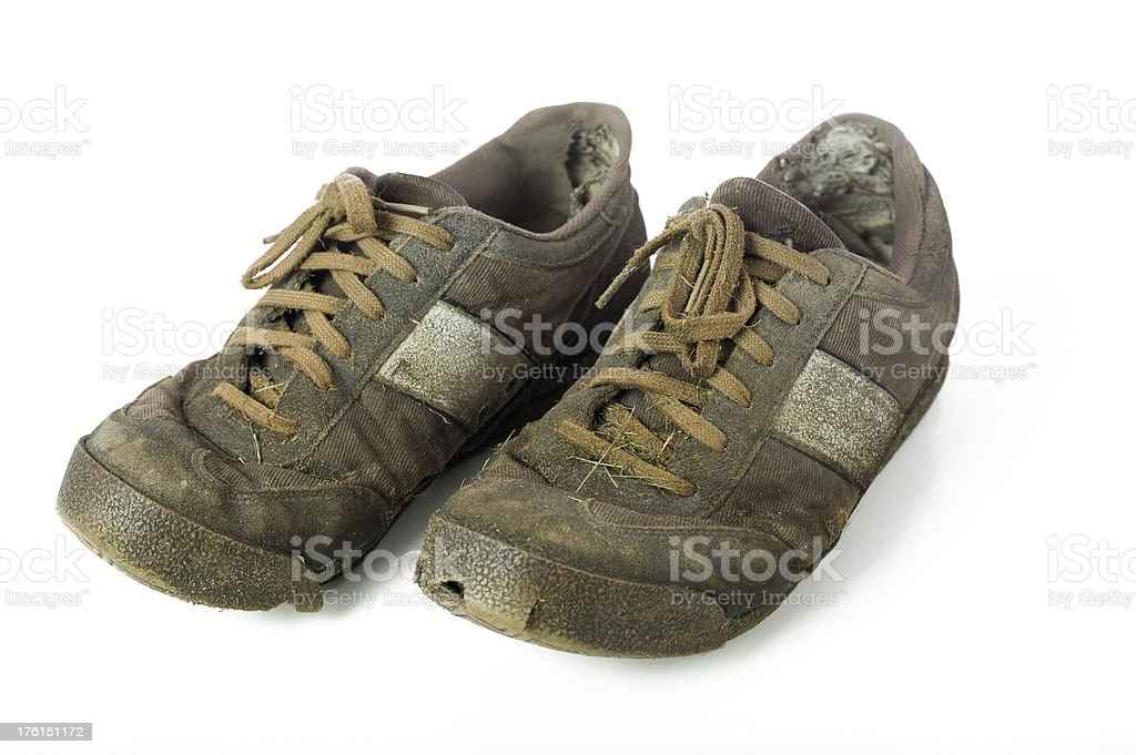 Pair of old worn out sneakers standing besides each other. royalty-free stock photo