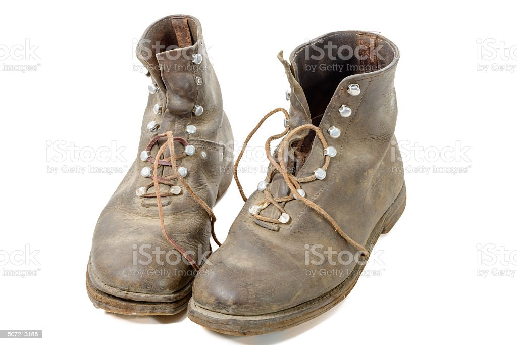 pair of old WW2 boots military isolated on white background stock photo