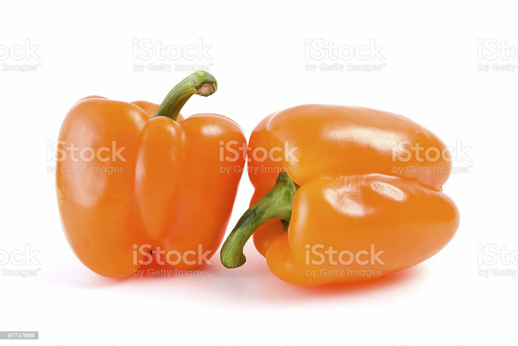 Pair of orange bell peppers stock photo