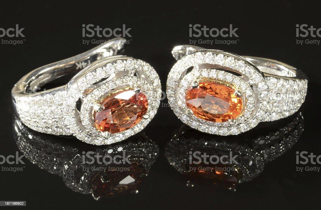 Pair of Orange Sapphire and Diamond Earrings royalty-free stock photo