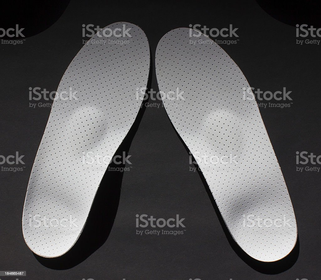Pair of orthopedical insoles. stock photo