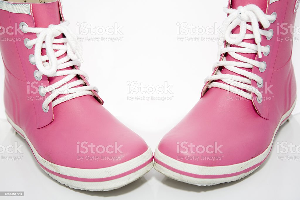 A pair of pink rubber wellingtons royalty-free stock photo