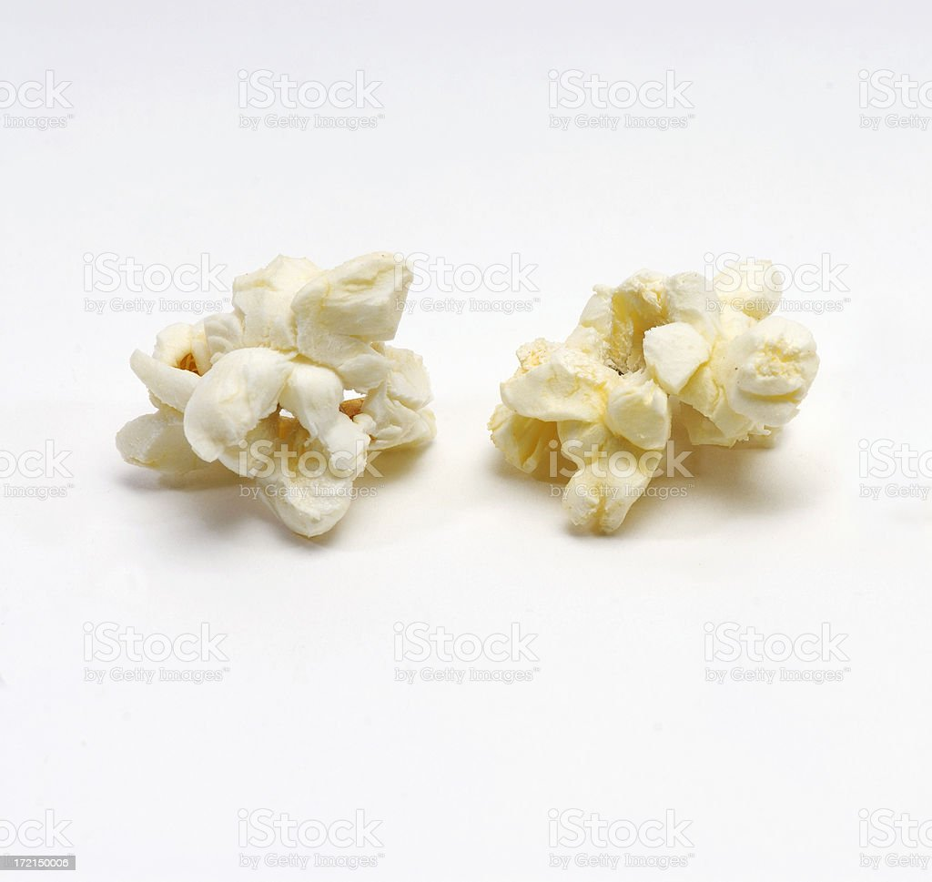 Pair of popcorn kernals royalty-free stock photo