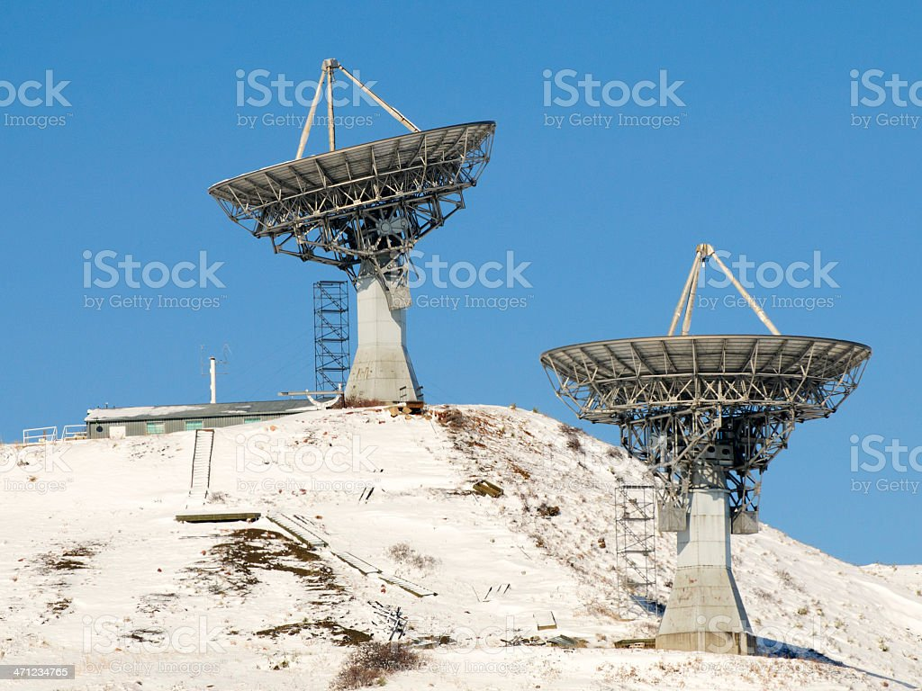 Pair of Radio Observatory Dishes or Antenna on a Hillside royalty-free stock photo