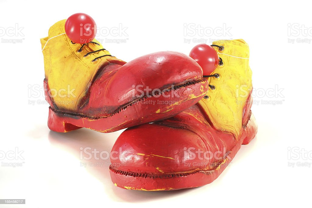 A pair of red and yellow clown shoes on white background royalty-free stock photo