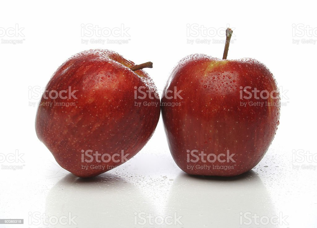 Pair of red apples with drops stock photo