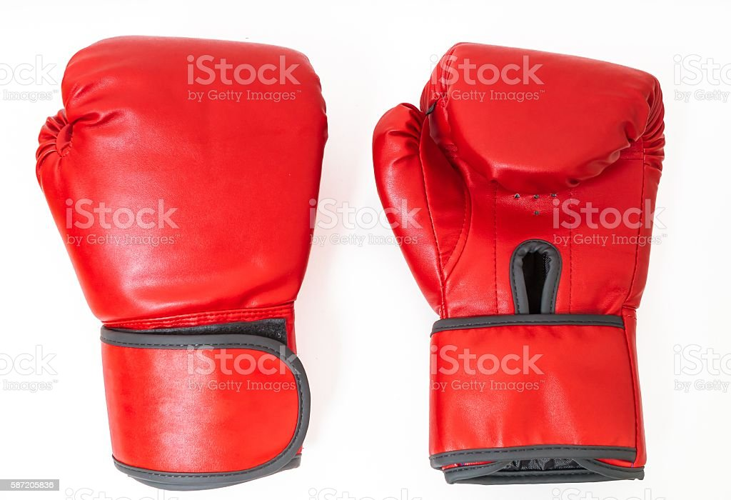 Pair of red boxing gloves isolated on white background. stock photo