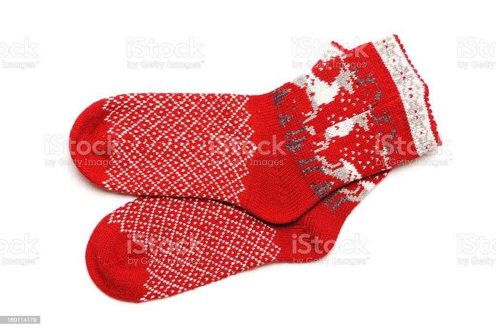 Pair of red Christmas socks with reindeer on white back royalty-free stock photo