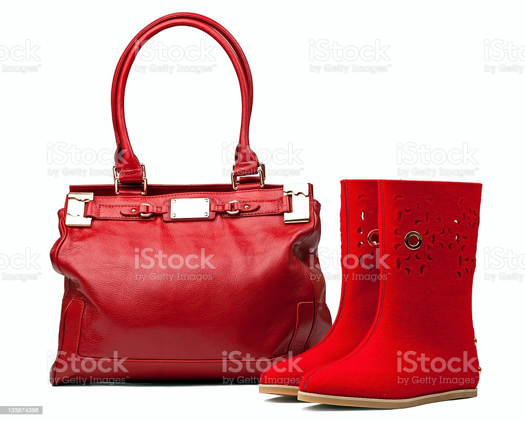 Pair of red felt boots and leather bag, with path royalty-free stock photo