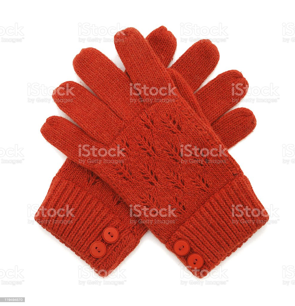 Pair of red knitted gloves crossed on a white background stock photo