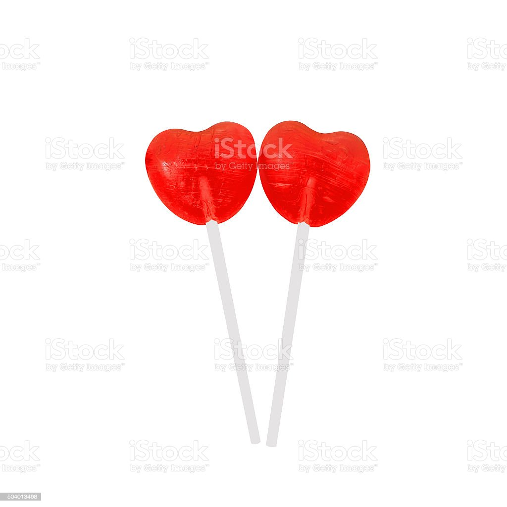 pair of red lollipops in heart shape stock photo