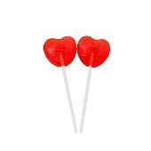 pair of red lollipops in heart shape