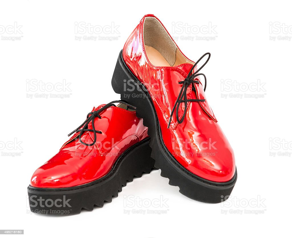 pair of red patent leather boots stock photo