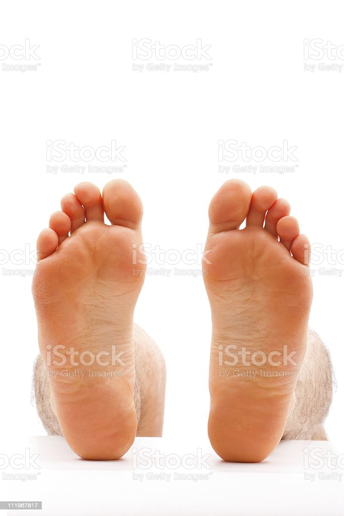 A pair of relaxing feet on top of a white background royalty-free stock photo