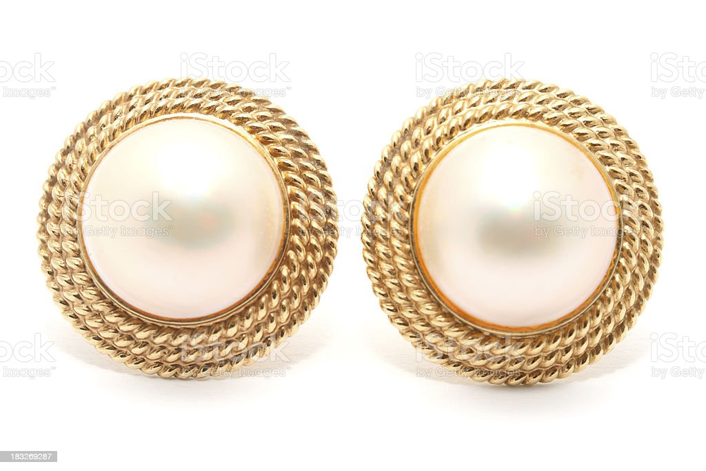 Pair of round pearl earrings on white background stock photo