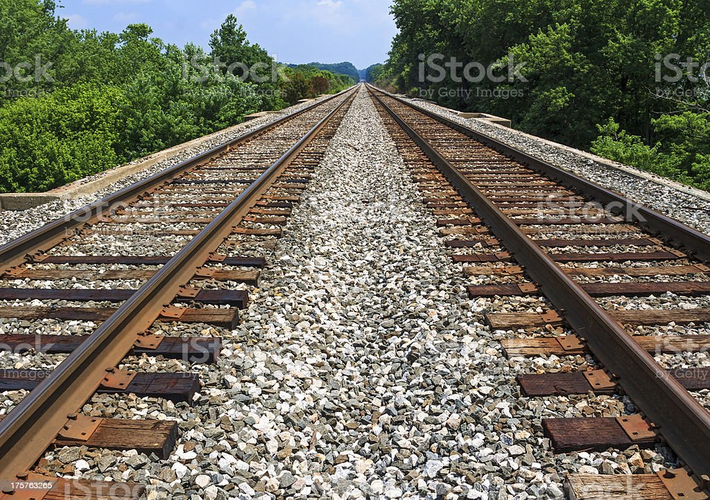 Pair of rusty railroads on a sunny blue day stock photo