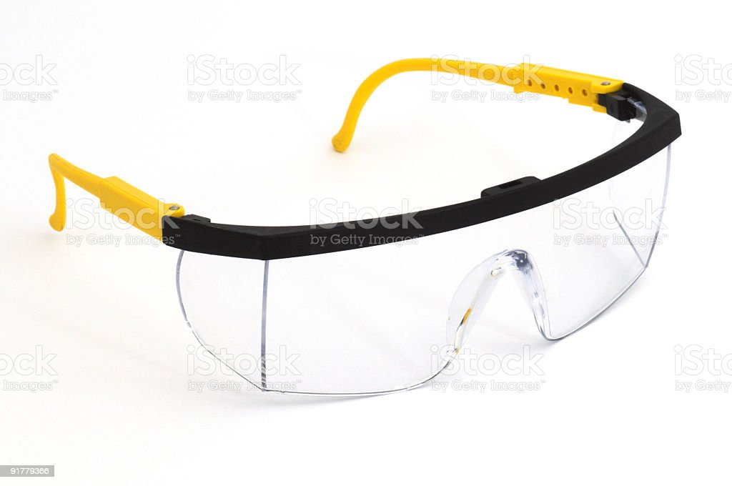 Pair of safety goggles on a background stock photo