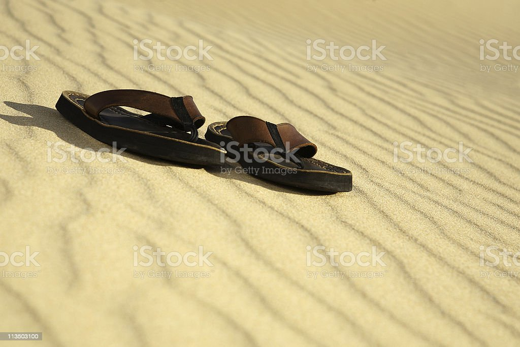Pair of sandals on the beach royalty-free stock photo