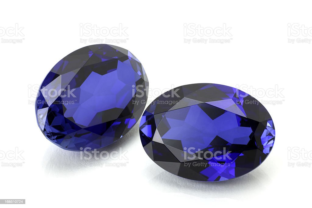 Pair of Sapphire or Tanzanite. royalty-free stock photo